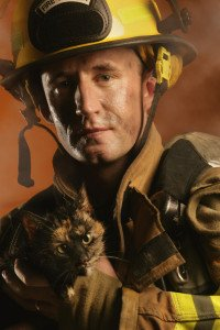 Fire Fighter Holding Cat